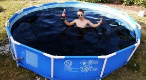 This is epic: Taking a Bath in a Giant 1,500 Gallon Coca-Cola Swimming Pool!