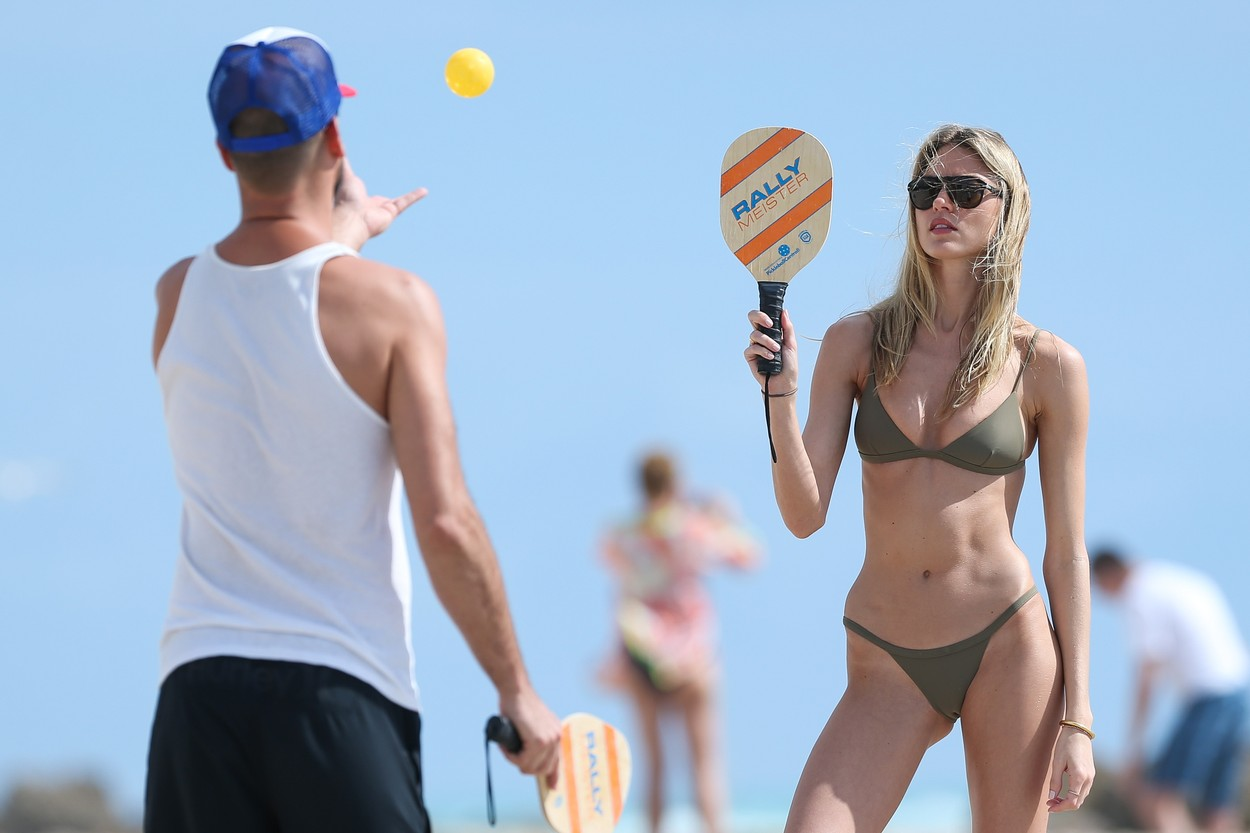 eef9202037 EXCLUSIVE  Green Goddess! Martha Hunt wears an olive green Solid and  Striped bikini as she plays a game of paddleball with her boyfriend Jason  McDonald on ...